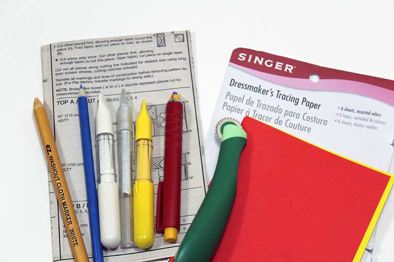 Marking your fabric pieces correctly is just as important as cutting out your fabric accurately. Learn about the different fabric marking tool options, what each tool is used for, and which pattern marks need to be transferred onto the fabric
